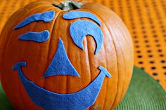 Fuzzy felt face jack-o-lantern - 15 Awesome No-Carve Pumpkins I Halloween No-Carve Pumpkin Ideas - ParentMap