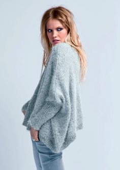 Long Cardigan in Bergere de France Plume and Galaxie - 42882. Discover more Patterns by Bergere de France at LoveKnitting. The world's largest range of knitting supplies - we stock patterns, yarn, needles and books from all of your favourite brands.