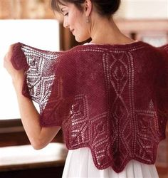 This shawl, which is based on the traditional Faroese method, fits neatly over the shoulders. A cascade of diamonds flows down the center back to the tip of the lower point. This pattern can be found in Margaret Stove's Wrapped in Lace. Other Things You May Like to Check Out:Thistle and Fern ShawlLacy Diamond Circular…