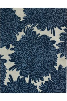 This blue and gray chrysanthemum wool rug by Martha Stewart is so pretty! Would look great in a dining room to really make a statement. (affiliate)