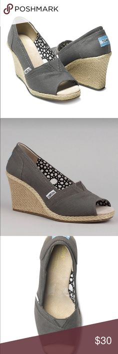 Toms Calypso Peep Toe Canvas Wedge Ash 9 Excellent barely used condition with only the most minimal signs of wear.  Size 9.  Color is Ash which is a dark grayish khaki/taupe.  Kinda like a charcoal gray.  Last three pics are the actual shoes available.  No box. Toms Shoes Wedges
