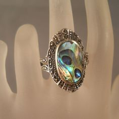 Vintage Sterling Abalone Marcasite Ring Size 9 Peacock Colors from Suzy's Timeless Treasures & Vintage Jewelry on Ruby Lane