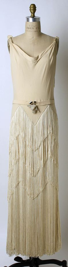 Cream silk evening dress with fringe skirt, by Mainbocher, French, 1937.