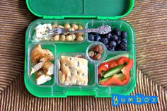 Mediterranean Diet inspired Yumbox: grilled chicken breast, feta cheese and chickpeas seasoned with oregano and olive oil, cucumber and red pepper slivers, flat bread, toasted hazelnuts and blueberries. #healthy #lunch