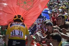 Team Sky's Chris Froome breaks through fans on the climb to Team Sky's Chris Froome