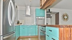 ✶High-rise condo with original 1950s robin's egg blue cabinetry wants $339K This bright two-bedroom, two-bath home combines mid-century flair with harbor views. While the majority of the Lakeview home is renovated and features updated appliances, special care was taken to preserve the midcentury modern robin's egg blue cabinets, terrazzo tile work, and ceramic sinks.✶