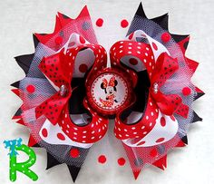 Very cute hair bow for your princess bow collection , this bow is made of grosgrain ribbon with a bottle cap as embellishment . ... is attached