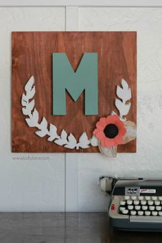 DIY project | Make this pretty monogram sign out of a surprise material: foam! Cute home decor that's easy to make!  So cute with mixed media felt flowers and coffee filter leaves. A great how-to on @LollyJaneBlog