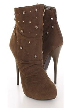 This very stylish ankle booties features faux suede upper, rhinestone embellishment,  slouchy detailing at mid foot, center stitching, semi point toes, cover platform and finished with back heels zipper closure. Insole with faux leather lining, lightly cushion foot-bed, out-sole with rubber traction. Approx 5 inch heels 1/2 inch platform.
