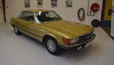 1973 Mercedes-Benz 350 SLC 3.5L 174,000 Km on the odometer. The car has an automatic transmission and equipped with ally wheels, leather seats, sun roof, air condition and more. The car present very well and gold is a beautiful color for this car. - K088