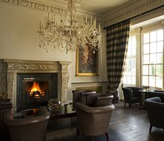 The cosy coat of arms lounge at Buxted Park Hotel, East Sussex.