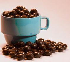 Homemade Chocolate Covered Coffee Beans.    http://www.justroasted.com/a/j/javamans-blog/38-chocolate-covered-espresso-beans