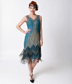 Pour this one over ice, dolls! The Somerset Flapper from Unique Vintage, boasts a knee-length shift style sheer overdress design in an enchanting teal blue that will surely make you stand out from the crowd. Elaborate hand beaded gold glass beads, teal se