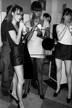 Models Kate Moss, Naomi Campbell and Michelle Hicks drinking shakes while wearing Stephen Sprouse at a reception party for the designer at Barneys in downtown New York