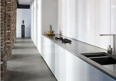 :: KITCHENS :: Photo Credit: Belgian architect Bruno Erpicum (see Architect Visit: Bruno Erpicum & Partners); we also like this warehouse conversion in Dusseldorf that Erpicum designed for an art-collecting couple. I am often inspired by the talents of Belgium based architects and designers for their use of space and materials, they have a sophisticated approach to design that is timeless and beautiful.  Love this conversion project with the original brick walls celebrated #kitchens