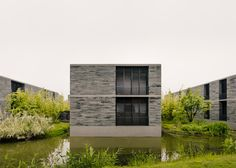 "David Chipperfield creates ""village"" of stone dwellings"