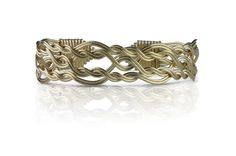 The Morning Glory has 12 strands of 14k Gold Artist Wire woven into a pattern last seen over 900 years ago in Scotland  The Morning Glory is on of the hardest items we have ever made and the beauty is mystifying.
