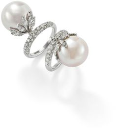 A pair of cultured pearl and diamond rings  Each designed as a cultured pearl, of peach and rose hues, set within a pavé-set diamond foliate cup articulated from a similarly set diamond half-hoop.