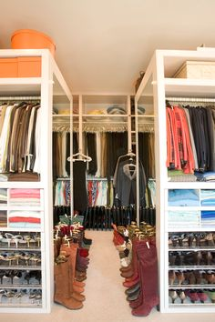 Gorgeous walk-in closet design with sliding glass shoe shelves, sweater cubbies and Hermes boxes.
