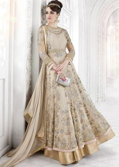 Elegant beige twin layered abaya suit in net heavily embellished with floral resham embroidery and stone work.