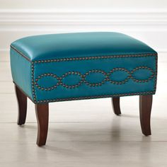 The architectural wood frame of our Stella Leather Ottoman creates the perfect counterpoint to its smooth and colorful cushioning.