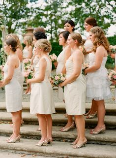 a sea of bridesmaids in white and cream  Photography by http://lisalefkowitz.com