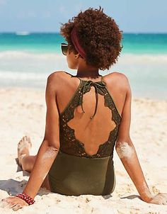 One piece, love and happiness. And happiness is ... a s'cute swimsuit & a lace back detail for extra WOW!
