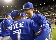 Toronto Blue Jays - 2015 American League East Division Champions Toronto Blue Jays' Josh Donaldson, right, celebrates with teammate Ben Revere after winning the first baseball game of a doubleheader against the Baltimore Orioles, Wednesday, Sept. 30, 2015, in Baltimore. Toronto won 15-2 to clinch the American League East. (AP Photo/Patrick Semansky).