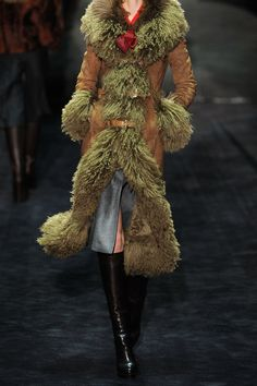 GUCCI  Belted shearling coat  $7,800