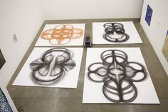 New Orlean's Performance Artist Uses Body and Charcoal ..This woman creates beautiful geometrical paintings with a stick of charcoal and movements of her body