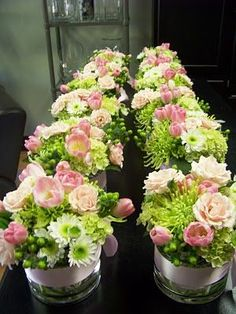 Lime green and pink. Green hypericum, green hydrangea, green fuji mums, pink tulips and pink majolica spray roses.
