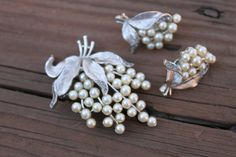 Vintage Crown Trifari Silvertone and Faux Pearl Brooch and Earring Set Demi Parure. $65.00, via Etsy.