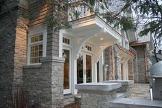 Fond Du Lac stone, gray paint on cedar shake, white trim, corbel detail.