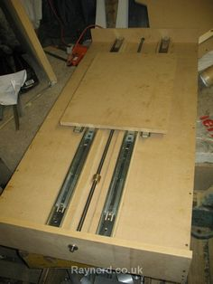 CNC Router by raynerd -- Homemade fixed gantry CNC router constructed from MDF, drawer slides, drill rod, and hardware. http://www.homemadetools.net/homemade-cnc-router-18