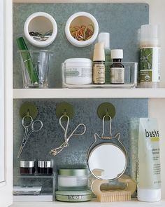 Affix a sheet of precut galvanized steel to cabinet interior with construction adhesive. Magnetic hooks now hold scissors and a mirror, and small plastic cups with magnetic bottoms corral small necessities, such as rubber bands and hair clips Medicine Cabinet Organization, Bathroom Organization, Bathroom Storage, Organization Hacks, Medicine Cabinets, Organized Bathroom, Cabinet Storage, Organize Medicine, Bathroom Closet
