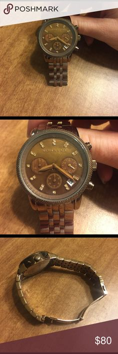 Michael Kors watch Chocolate Michael Kors watch- in perfect condition!!! *needs new battery* I've only worn this watch a few times. Some links have been taken out. Will negotiate on price!!! Make me an offer. *disregard how horrible my nails look!!!!* Michael Kors Accessories Watches