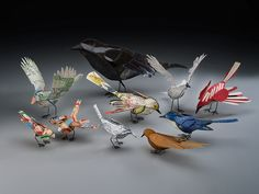 Anne Lemanski. Bird Group. 2009 Copper rod, mixed media, artificial sinew Variable dimensions.  Anne is a North Carolina artist.  Paper finch adorability