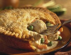 Chicken pot pie with the crust opened with a fork