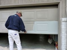 Garage door re-paint, the easy way. Tutorial here: diyhomestagingtip. Garage door re-paint, the ea Garage Door Paint, Garage Door Colors, Garage Door Makeover, Garage Door Design, Garage Door Repair, Garage Door Opener, Diy Garage, Garage Ideas, Garage Storage