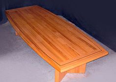Gorgeous red oak conference room table designed by Neal Burns.
