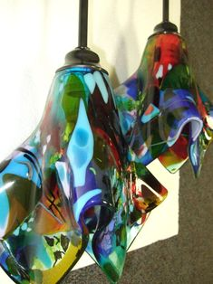 We created three very unique and colorful fused glass pendant lights for our client in the Outer Banks of North Carolina.  The lights are multiple layers of glass full fused to give a flat and shi...