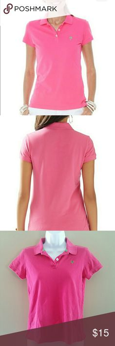 Lilly Pulitzer Island Polo Shirt Pretty pink Island polo shirt from Lilly Pulitzer. Small slits at bottom of each side. 20 3/4 inches from shoulder to bottom of hem. 95% Pima cotton 5% spandex. Lilly Pulitzer Tops