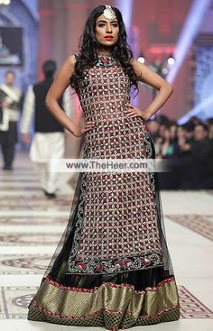 BW6997 Persian Plum Black Crinkle Chiffon Lehenga Designer presents a gorgeous lehenga outfit with a splendid design and detailing that will be a stunning addition to your wardrobe.. .   Top: Persian Plum Crinkle Chiffon Shirt features stunning and amazing embellishments accentuates the neckline, all over the front, side chalks and hemline. Sleeveless. Bateu or Boat neckline. Concealed zip closure back. Edges finished.   Bottom: Black Crinkle Chiffon Comes with plain flared lehenga adorned…