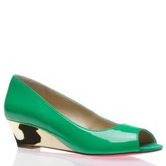 this is neat! it's like mix between a mini-heel and a ballet flat, with a pop of color. my kind of shoe!