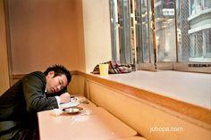 KFC Coupons at http://www.couponscrate.com/kfc-coupons/ Man sleeping at   kentucky fried chicken from Shinjuku,  Tokyo, Japan.