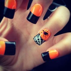 Spider and web themed Halloween nail art design. Let your French tips take a horrifying turn with this black and orange color combination.
