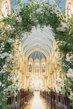Flowering arch with roses at a cathedral wedding ceremony.  St. Monica's Church in NYC. Trent Bailey Photography