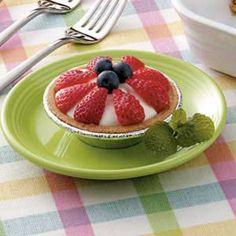 Simple fruit tarts. I would use raspberries and kiwi as the fruit.