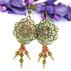 #EJWTT Filled with fun, flirty goodness, the FILIGREE FANCY Victorian inspired handmade earrings will make you feel special every time you put them on.  Lightweight and sparkly, the one of a kind earrings feature brass filigree component charms, Swarovski crystals, copper and sterling silver.