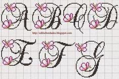Hobby lavori femminili - ricamo - uncinetto - maglia: alfabeto farfalla punto croce
